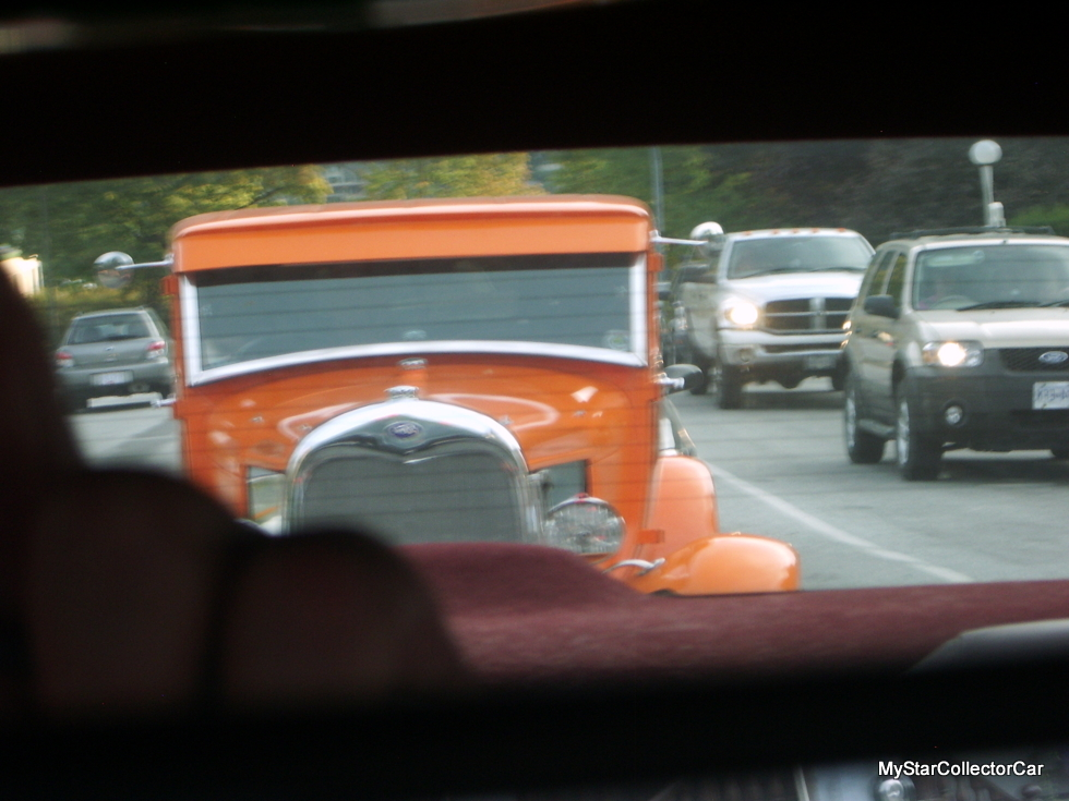 leaving Kaslo Orange Ford vehicle in Olds rearview mirror 2011 trip 2